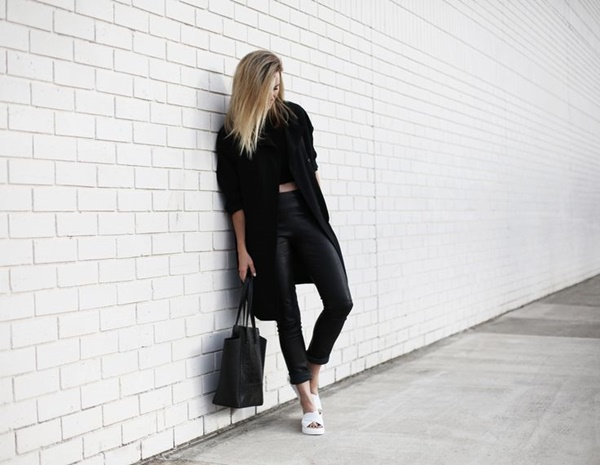 Black crop top over black leather pant
