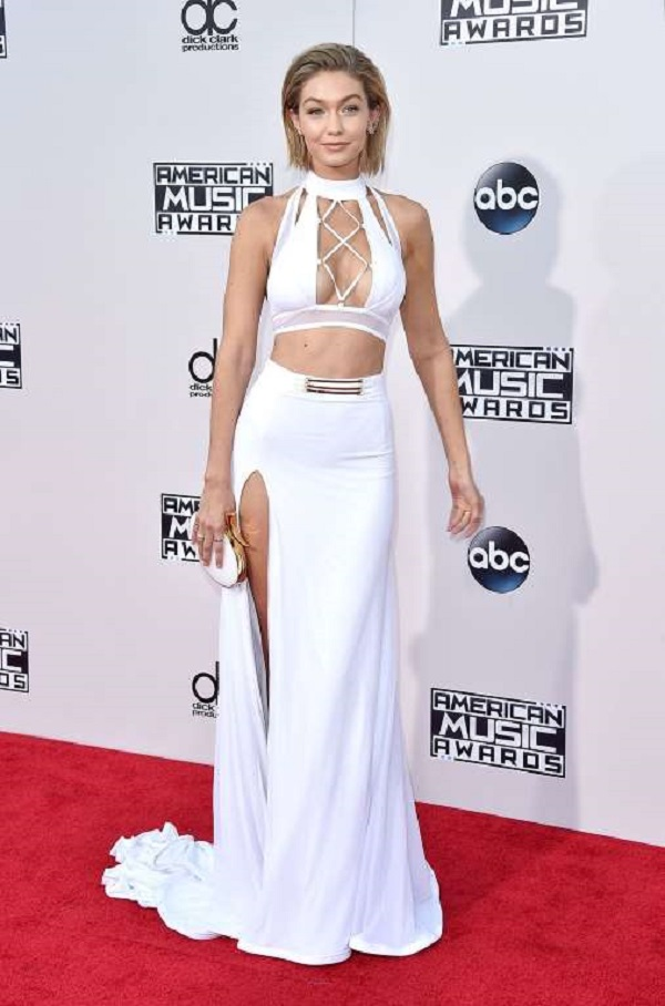 The model packed in oomph in an all-white ensemble featuring a two piece gown with deep neckline and a thigh-high slit at the 2015 American Music Awards at Microsoft Theater on Nov. 22, 2015 in Los Angeles, California, USA.