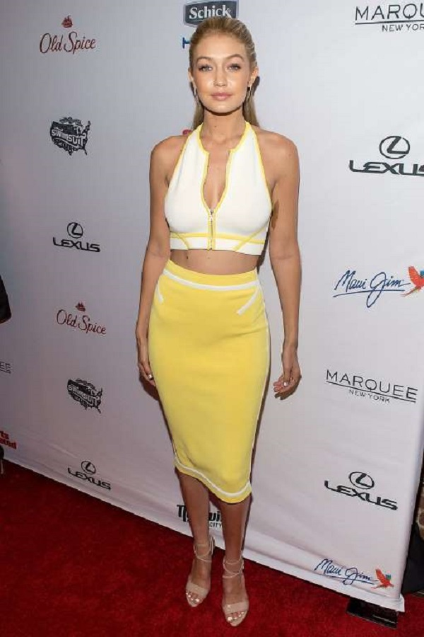 In a yellow two-piece attire and nude strappy sandals at the Sports Illustrated Swimsuit Issue celebration on Feb. 10, 2015, in New York City.