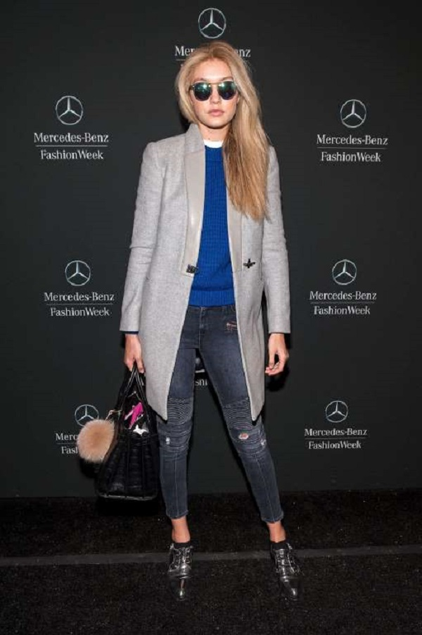She pulled off a casual look featuring an Ann Taylor sweater, Fay jacket, Lovers + Friends jeans, and Krewe Du Optic sunglasses at the Mercedes-Benz Fashion Week Fall 2015 in New York City on Feb. 18, 2015.