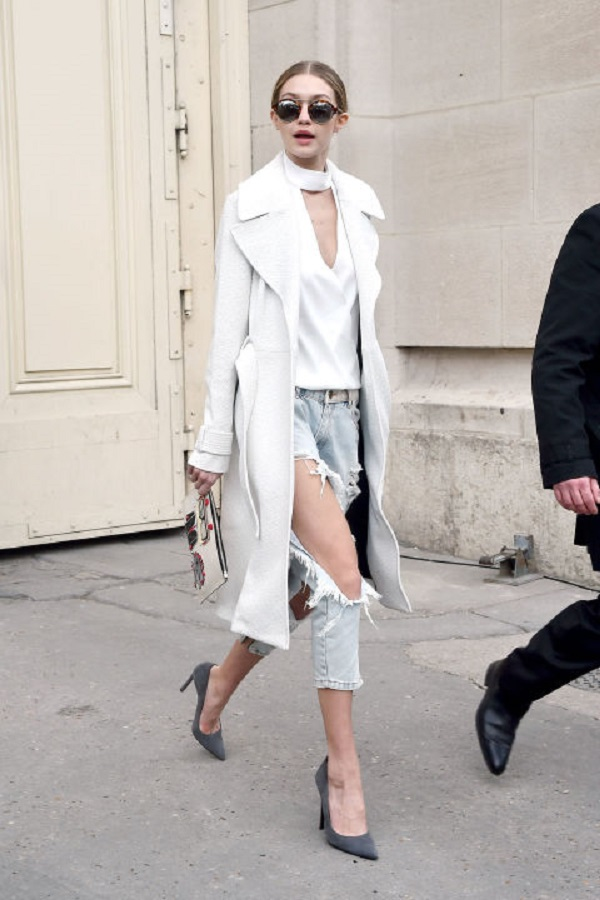 Gigi showed her toned legs in one x oneteaspoon distressed denim with a simple but elegant silky white top, A.L.C. coat and pointy gray heels with round sunglasses.