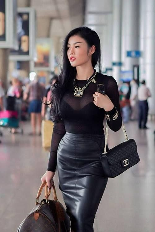 Leather skirt and sheer blouse