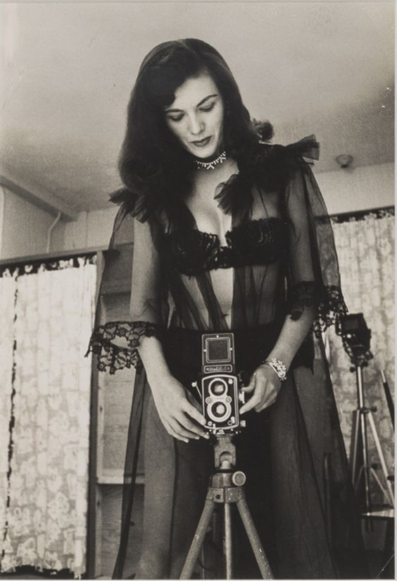 Bunny Yeager in Black Lace with Her Rolleiflex Camera, 1955