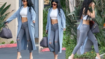 kylie jenner distressed grey skinny jeans and a white crop top main