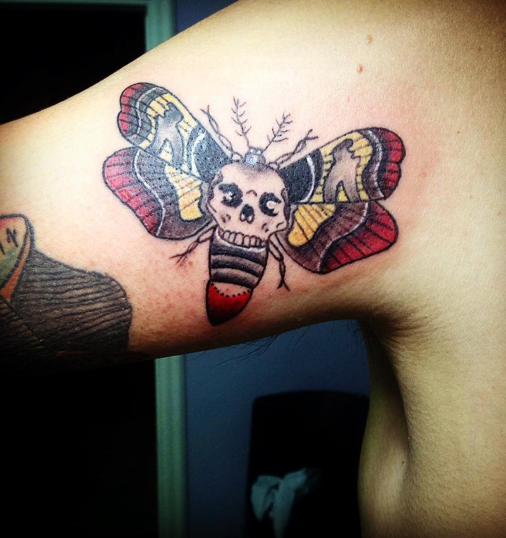 skull-tattoo-designs-61-arm-fly