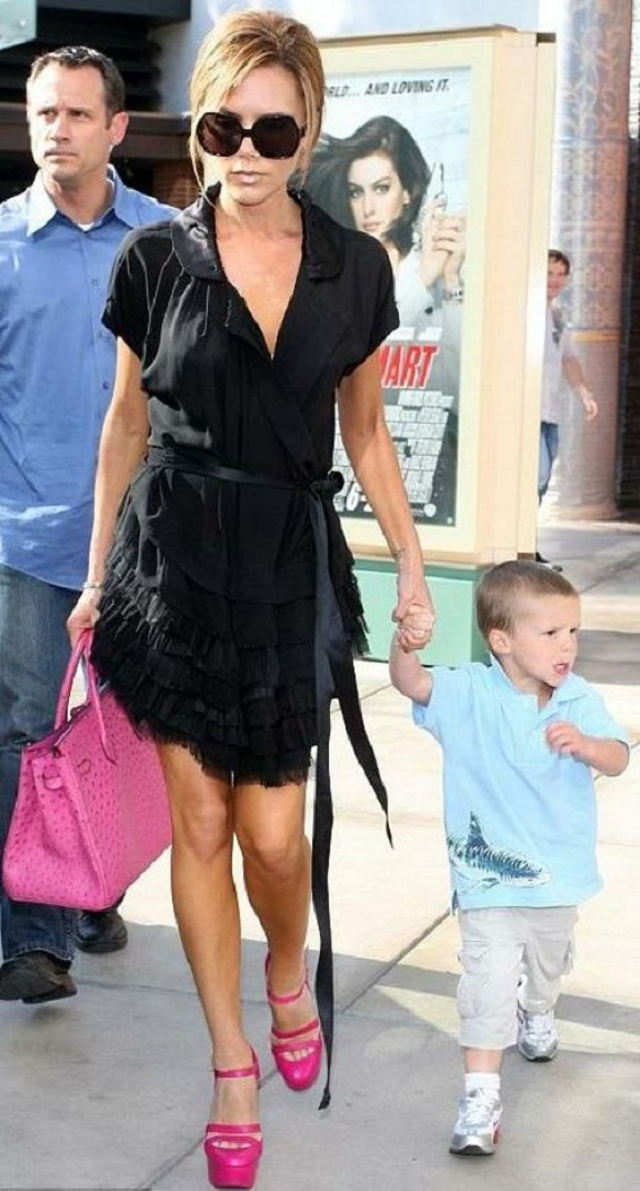 posh-wearing-black-dress-with-brigt-pink-shoes