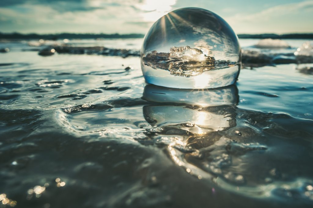 photography ideas with transparent glass sphere